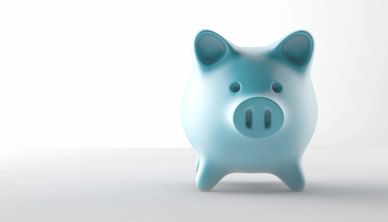 A teal piggy bank set against a white background.